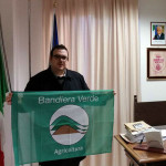 Davide Dellonti con la Bandiera Verde